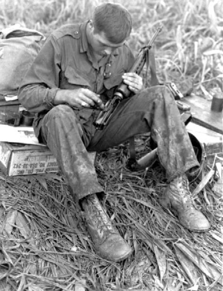 Soldier Cleaning His Rifle