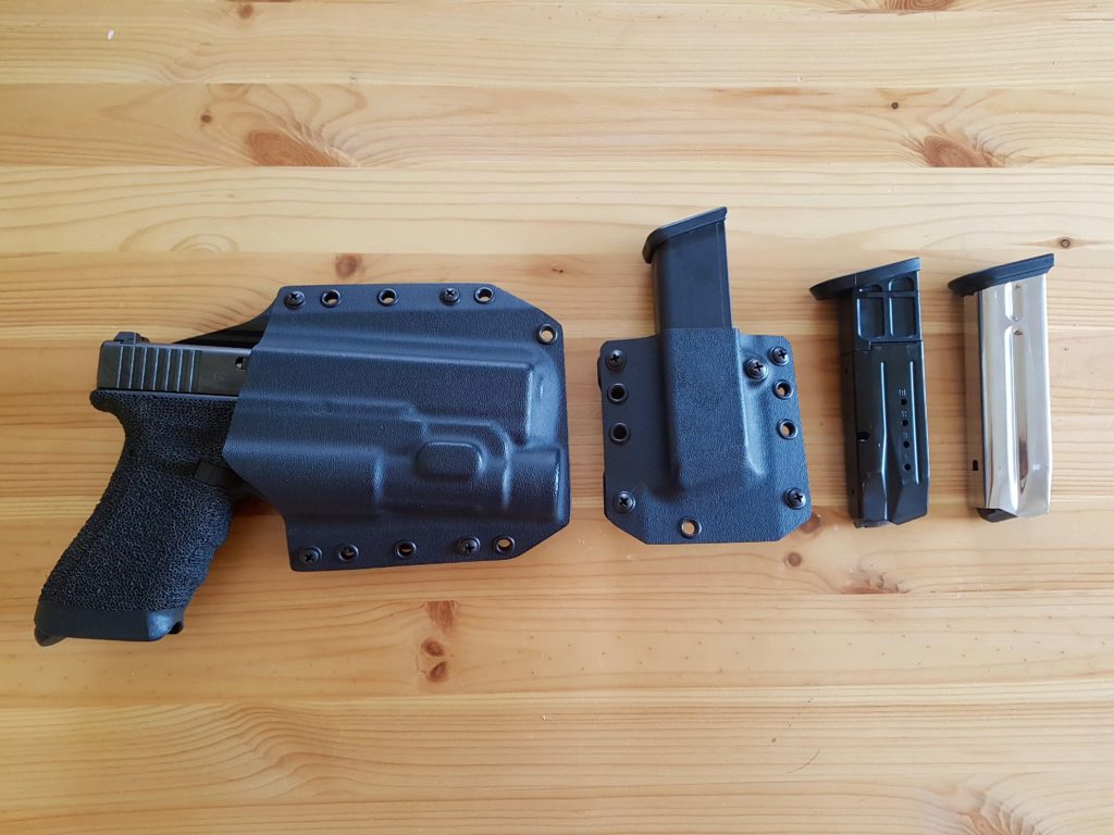 Bravo Concealment, Glock 17 with TLR-1 and Mag Pouch