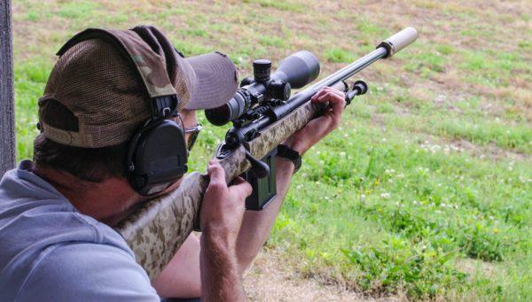 Shooting with silencer and earmuffs