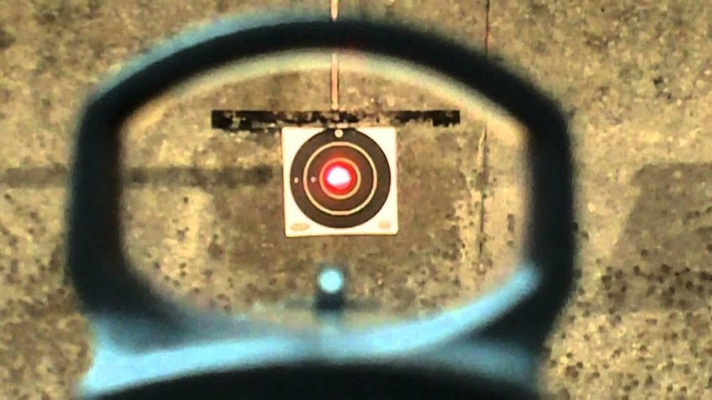 red dot sight aiming at bullseye