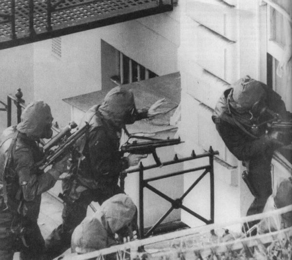 SAS members shooting with single point sling