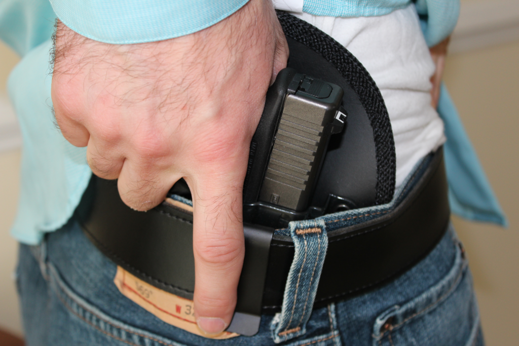 Concealed carry using waist holster
