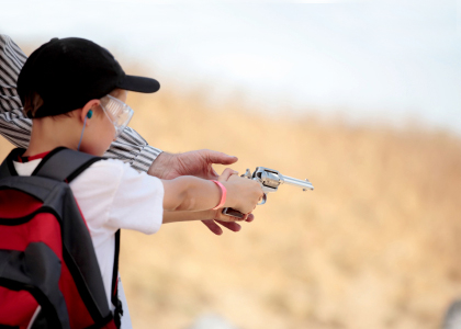 Young Boy Firearms Training with a revolver
