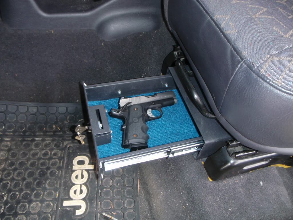 handgun in safe under drivers seat in jeep