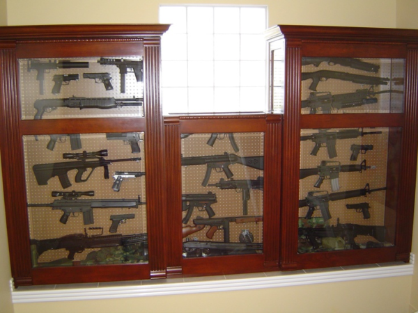 Safe secure ways to display your gun collection pew pew tactical the frames around the glass in the doors and added bars will help prevent someone from removing the long guns but dont protect the handguns planetlyrics Choice Image