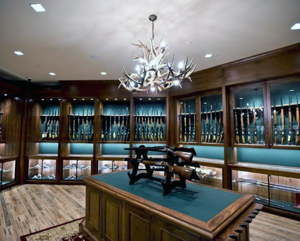 Room full of firearm display cabinets.