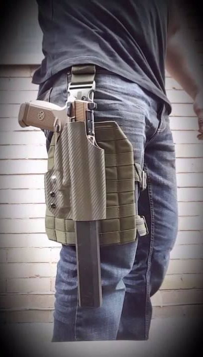 Osprey attached to holstered handgun