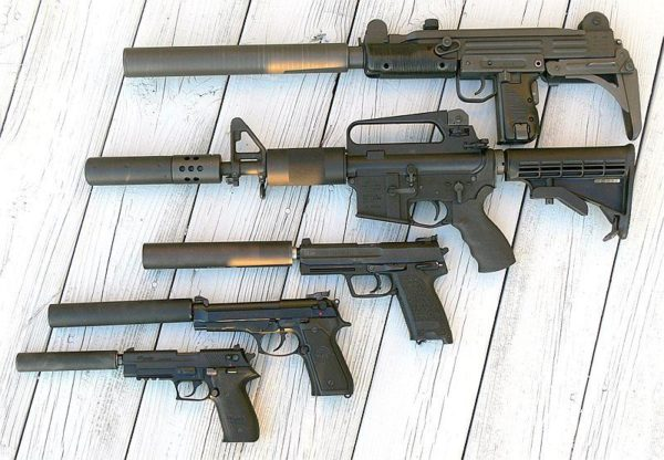 Various firearms equipped with suppressors