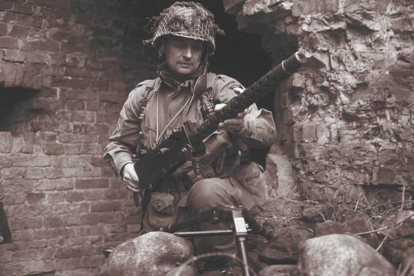 World War II Soldier Preparing to Mount M2 Machine Gun on a Tripod