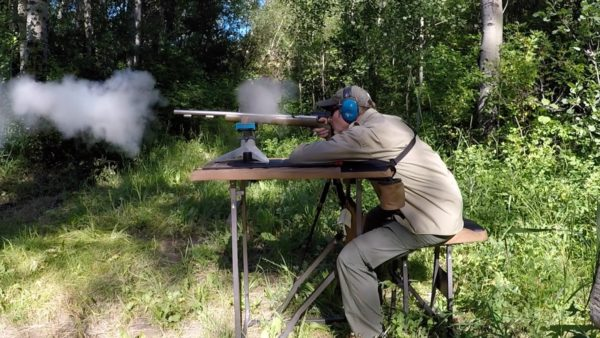 man shooting muzzleloading rifle