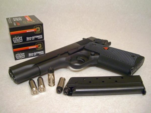 Colt Delta Elite with Boxes of Black Talon 10mm Ammo