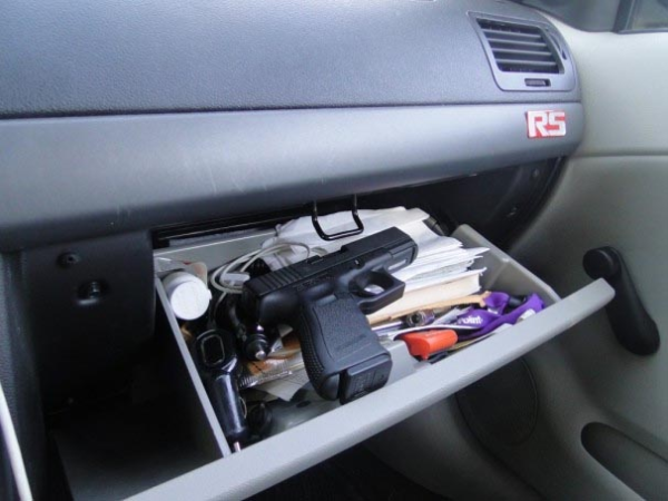 Glock pistol in glove compartment