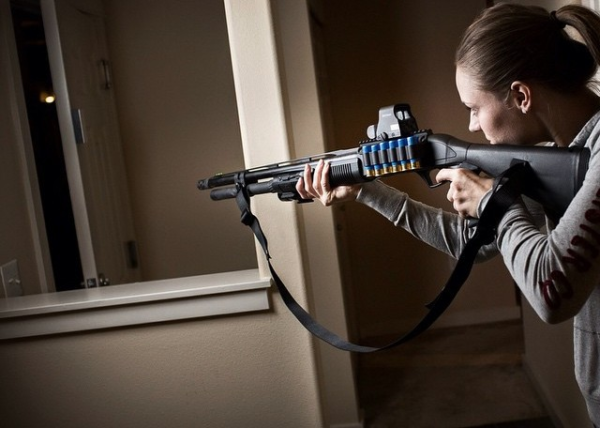 Woman defending home with shotgun