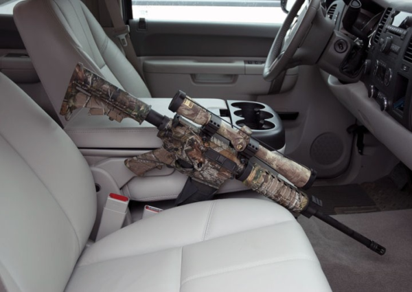AR style rifle wedged next to front passengers seat