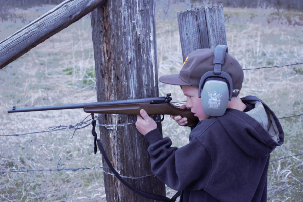 Boy shooting rifle