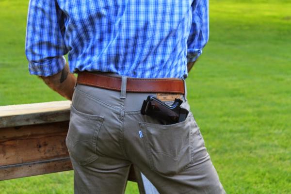 Carrying handgun in back pocket