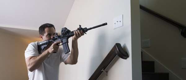 Man defending home with AR-style rifle
