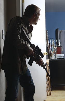 Man defending with rifle