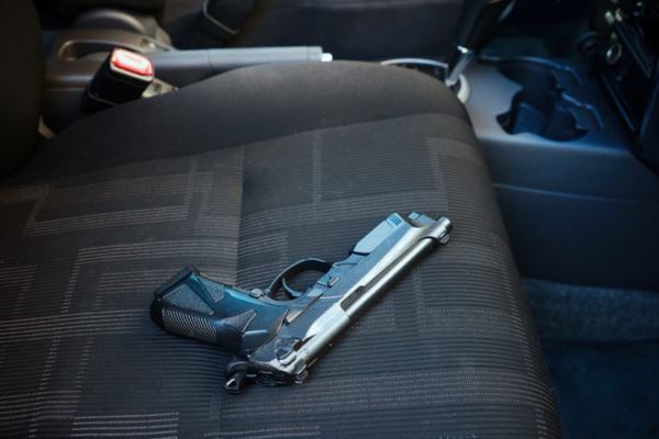 Pistol on passenger's seat