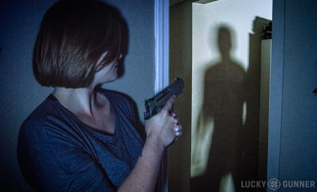 Woman defending home with pistol