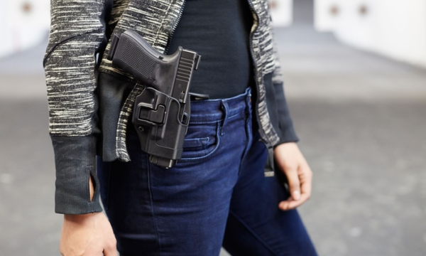 woman carrying pistol in waistband holster