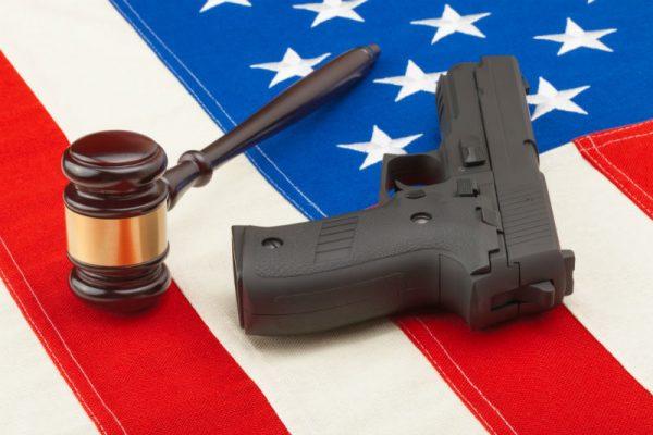 pistol, gavel, and american flag