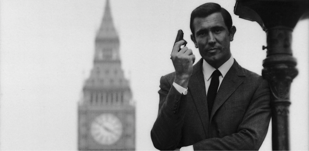 Promotional Image for On Her Majesty's Secret Service of Lazenby with a Walther PPK