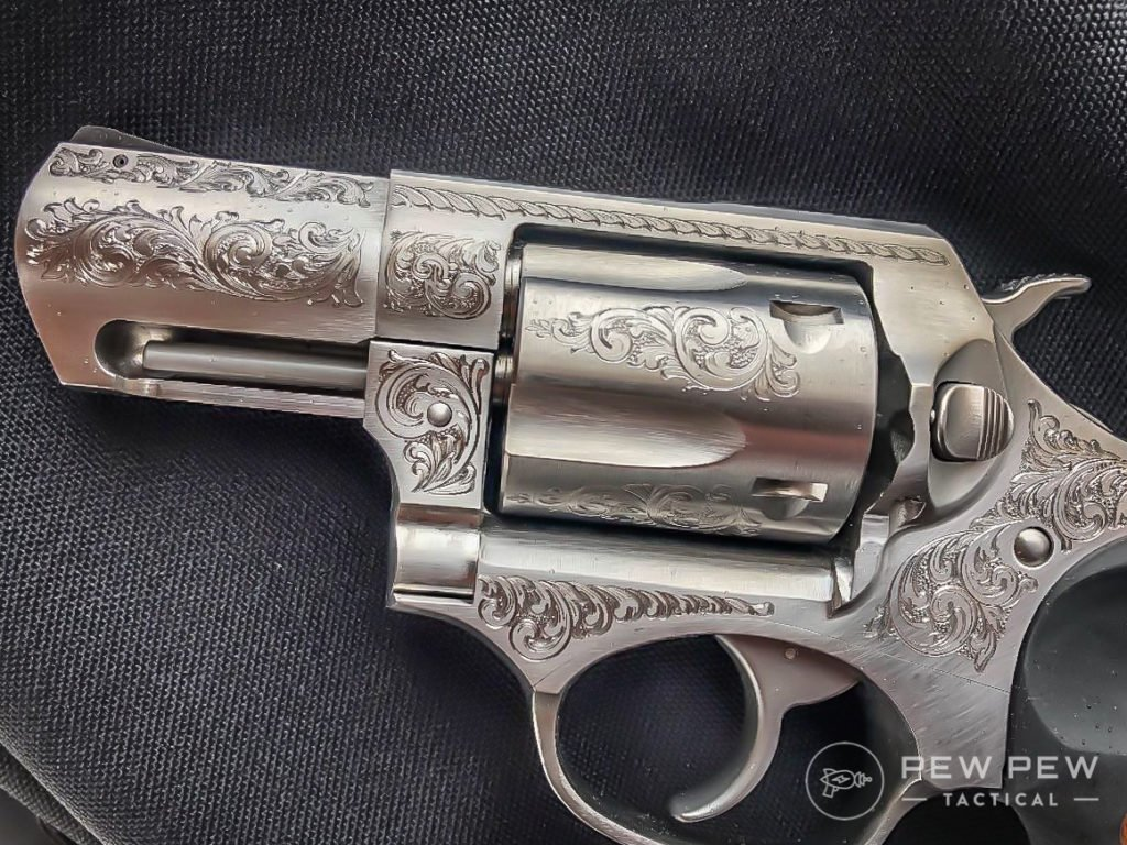 The engraving work on this pistol is beautiful, also, note the shrouded ejection rod