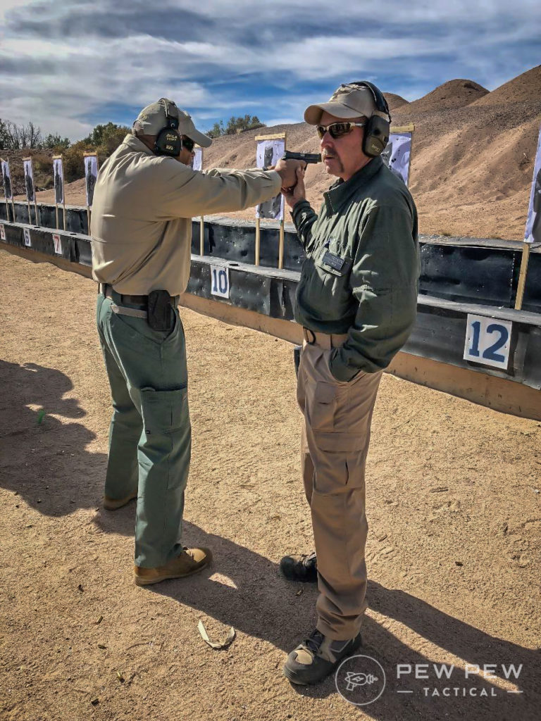Joe (left) and Gary (right) demonstrate how at close distance, only the front sight is critical.