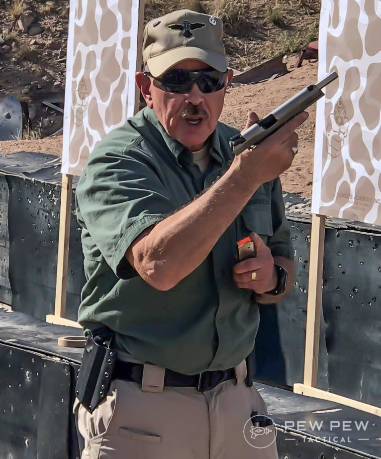 Gunsite is a fighting school, not just a shooting school.  Here Randy demonstrated reloading in your workspace so you can stay aware of threats (no head down).