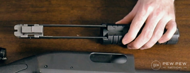 Bolt carrier into notches on rails