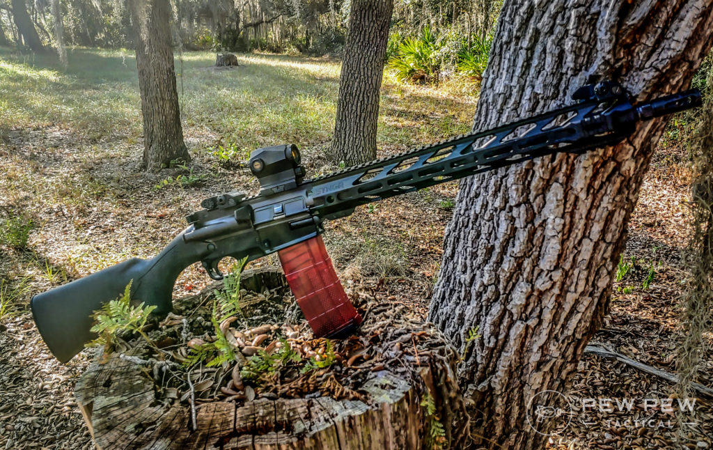 Ares SCR leaning on trees