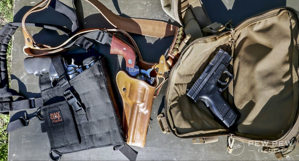 L to R Man Gear Alaska Chest Holster, Diamond D Guides Choice Chest Holster, Hill People Gear Kit Bag