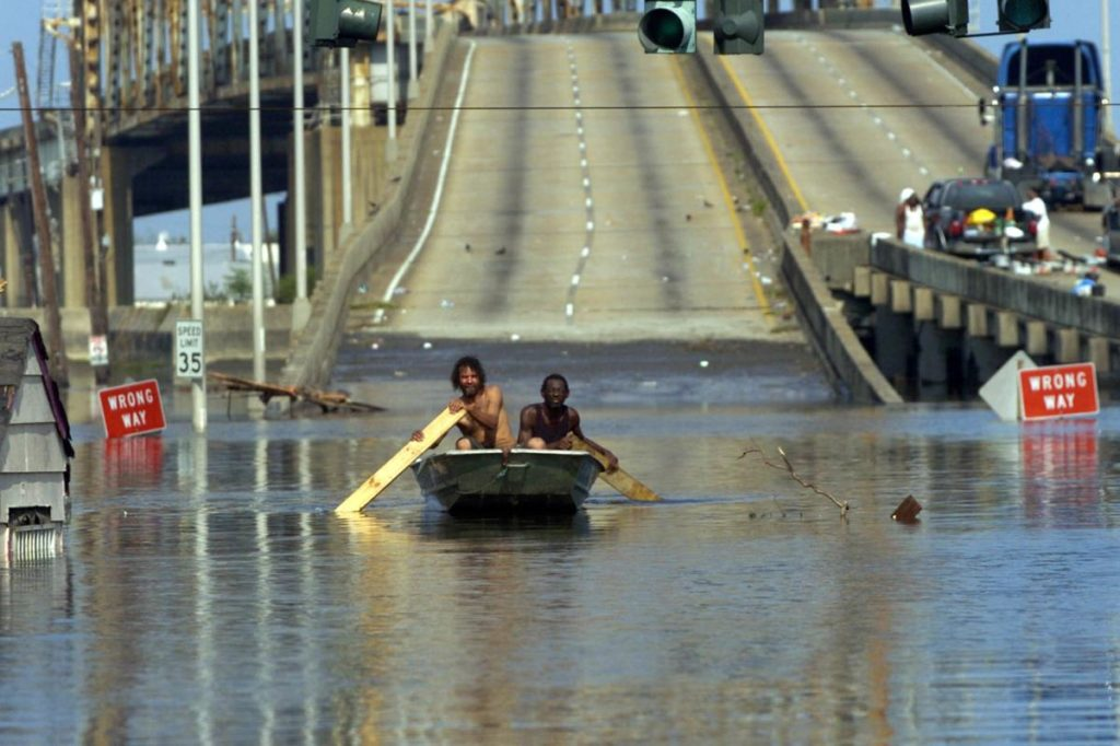 Residents boat on the highway during Katrina