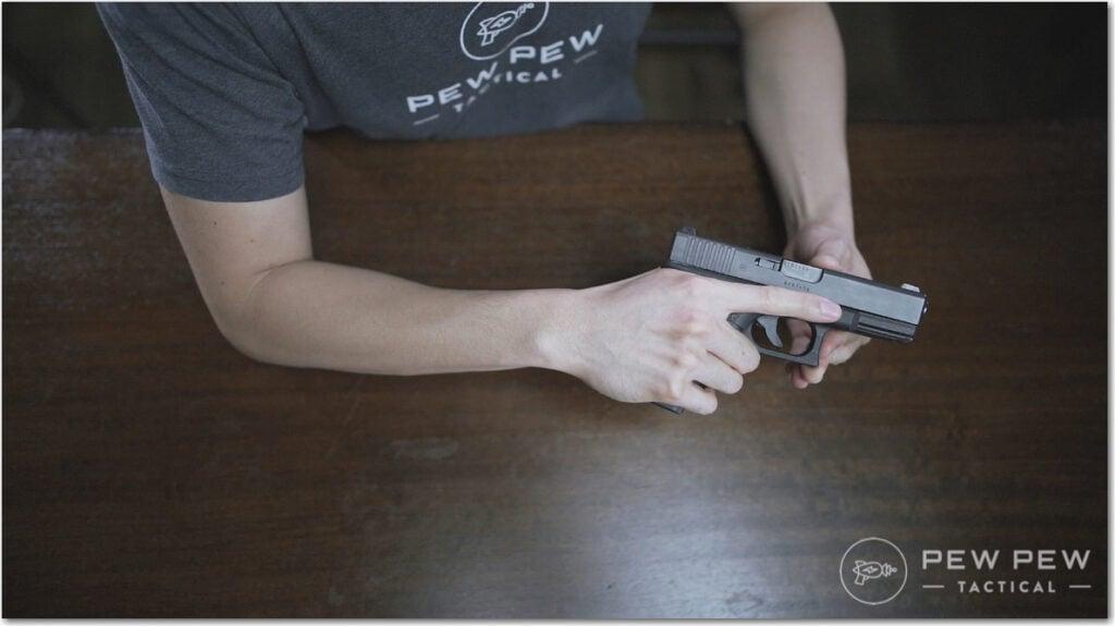 Handgun Three Grip with Index Finger Along Slide
