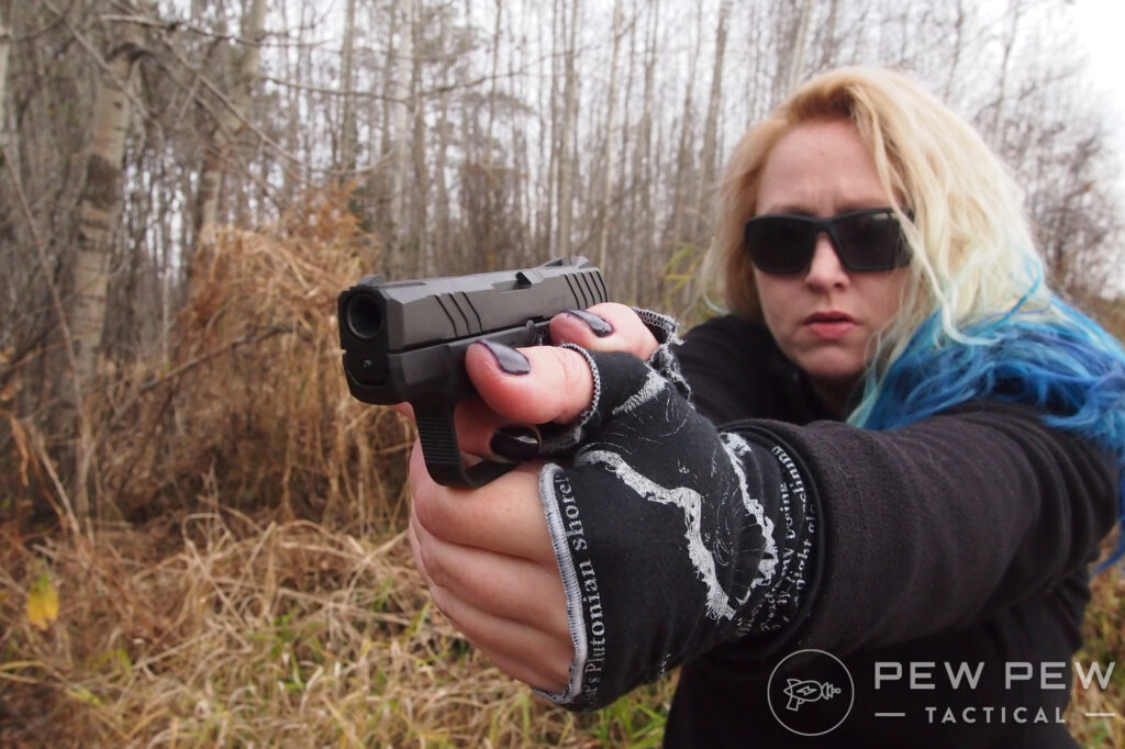 Kat with Gloves and a Pistol