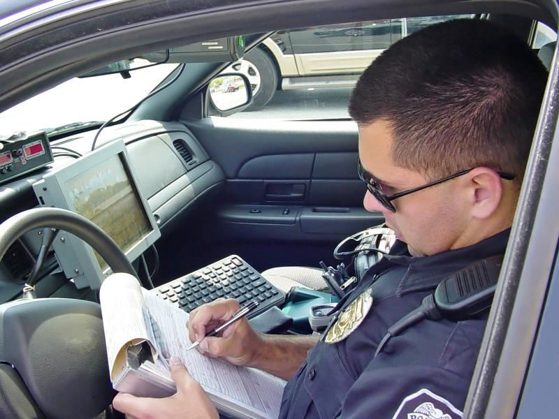 Officer writing a police report
