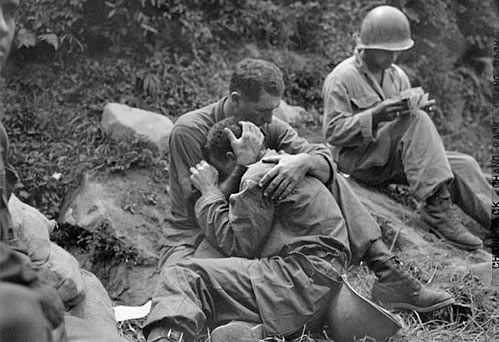 Soldiers comforting each other in the trenches