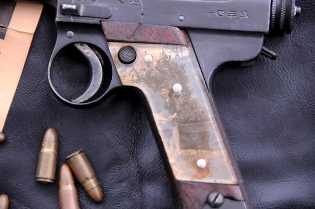Sweetheart grip on a captured Japanese Nambu pistol