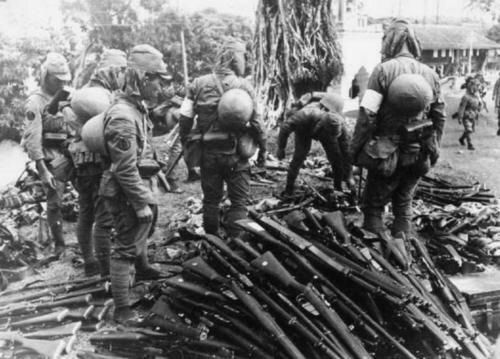 WWII Rifles piled up