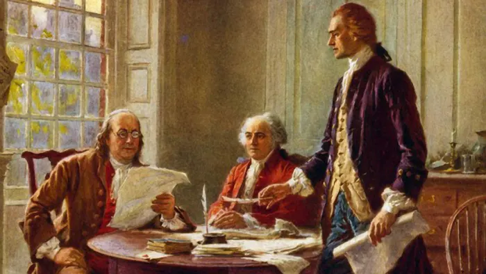 Benjamin Franklin and John Adams meeting with Thomas Jefferson, standing, to study a draft of the Declaration of Independence. (Credit: Universal History Archive/Getty Images)